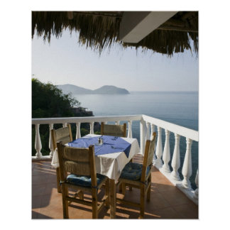 Mexico, Guerrero, Zihuatanejo. Cafe Table over Poster