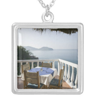 Mexico, Guerrero, Zihuatanejo. Cafe Table over Silver Plated Necklace