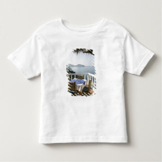 Mexico, Guerrero, Zihuatanejo. Cafe Table over Toddler T-shirt