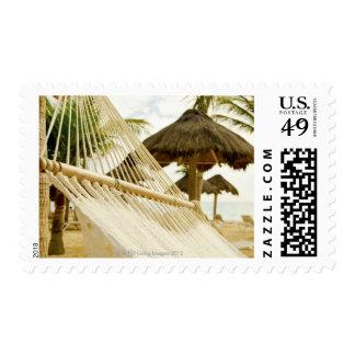 Mexico, Playa Del Carmen, hammock on beach Postage