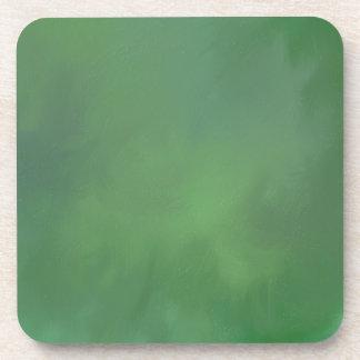 mezcla abstracta verde de la pintura posavasos