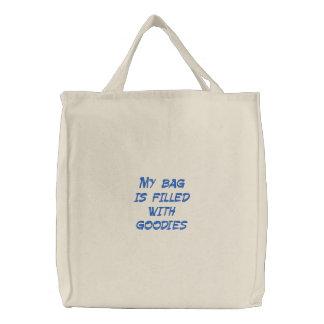 Mi bolso se llena de las chucherías bolsa de tela bordada