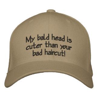 ¡mi cabeza calva es más linda que su mún corte de  gorra de béisbol