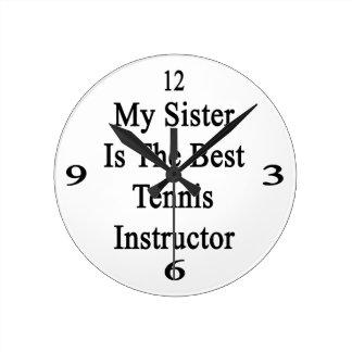 Mi hermana es el mejor instructor del tenis reloj de pared