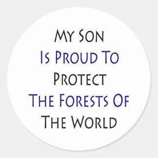 Mi hijo es orgulloso proteger los bosques del Worl Pegatina Redonda