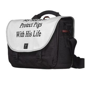 Mi hijo protegerá cerdos con su vida bolsas para ordenador