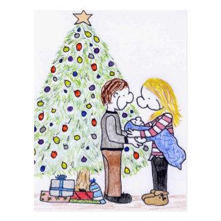 Mi postal del navidad de la familia de la gente