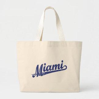 Miami script logo in blue distressed canvas bags