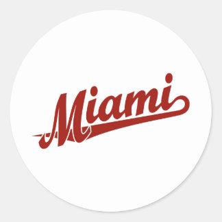 Miami script logo in red round stickers