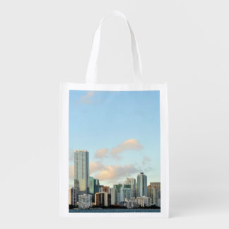Miami skyscrapers against wide clear sky grocery bags
