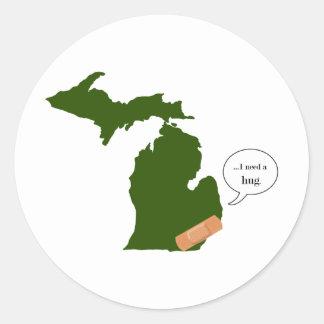Michigan necesita un abrazo pegatina redonda