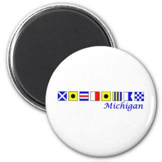 Michigan spelled in nautical flag alphabet 2 inch round magnet