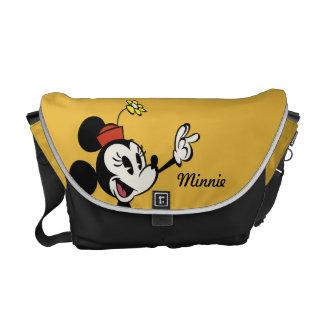Mickey principal pone en cortocircuito la mano del bolsa de mensajeria