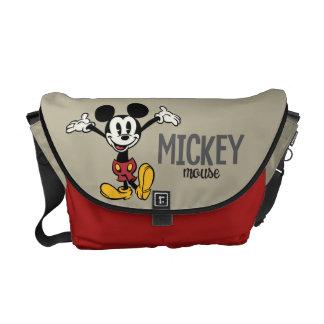 Mickey principal pone en cortocircuito los brazos bolsas messenger