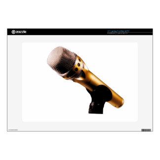 Micrófono de oro skins para portátiles