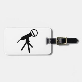 Microphone press luggage tag
