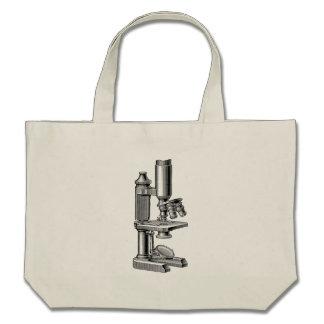 Microscopio antiguo viejo del equipo de la ciencia bolsas de mano
