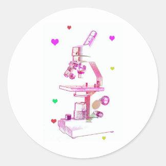 microscopio en rosa pegatina redonda