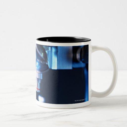 Microscopio óptico 3 tazas de café