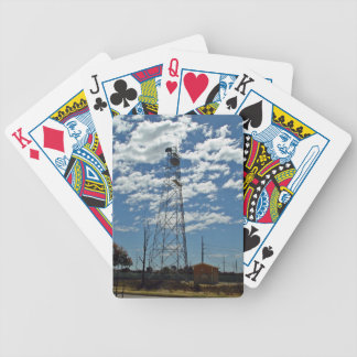 Microwave relay dishes on a communications tower bicycle playing cards