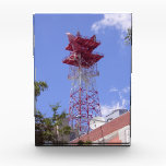 """Microwave Relay Radio Telecom Tower Award<br><div class=""""desc"""">Microwave wireless telecommunications tower for microwave relay service stands above the telephone company central office downtown.</div>"""