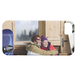 Mid adult couple embracing outside log cabin iPhone SE/5/5s case