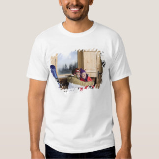 Mid adult couple embracing outside log cabin tee shirt