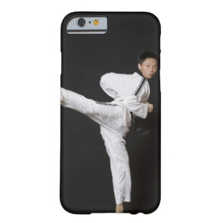 Mid adult man performing the side kick barely there iPhone 6 case