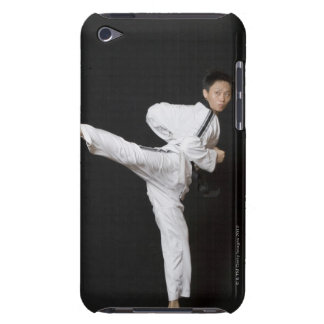 Mid adult man performing the side kick barely there iPod covers