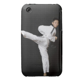 Mid adult man performing the side kick iPhone 3 cover