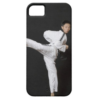 Mid adult man performing the side kick iPhone 5 cover