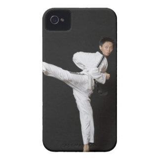 Mid adult man performing the side kick iPhone 4 case