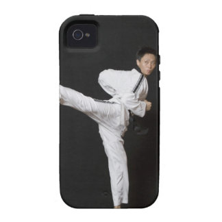 Mid adult man performing the side kick vibe iPhone 4 cover