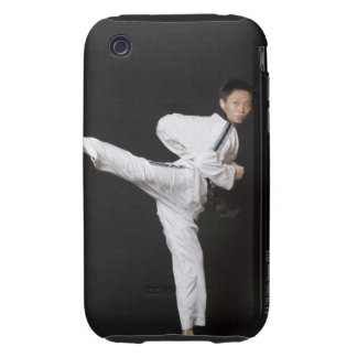 Mid adult man performing the side kick iPhone 3 tough case