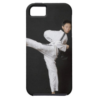 Mid adult man performing the side kick iPhone SE/5/5s case