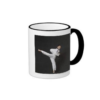 Mid adult man performing the side kick ringer coffee mug