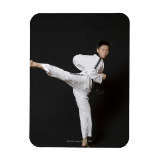 Mid adult man performing the side kick rectangular magnet