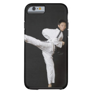 Mid adult man performing the side kick tough iPhone 6 case