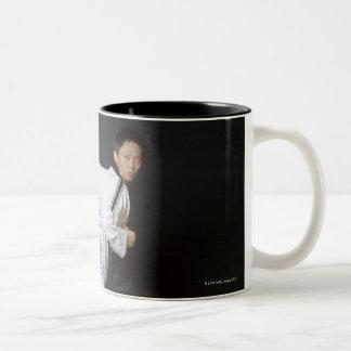 Mid adult man performing the side kick Two-Tone coffee mug