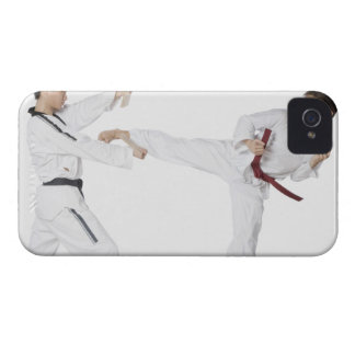 Mid adult man practicing kickboxing with a young iPhone 4 case