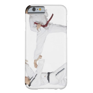 Mid adult man practicing kickboxing with a young barely there iPhone 6 case