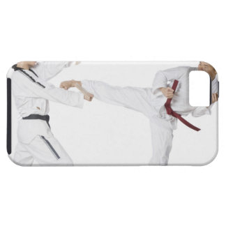 Mid adult man practicing kickboxing with a young iPhone 5 cover