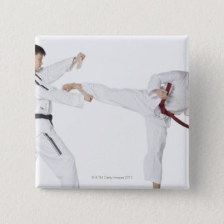 Mid adult man practicing kickboxing with a young pinback button