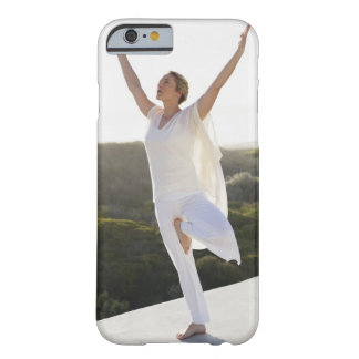 Mid adult woman practicing yoga 2 barely there iPhone 6 case