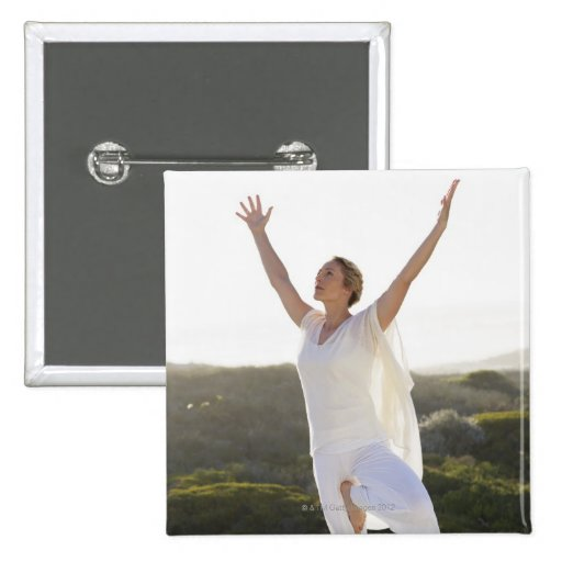 Mid adult woman practicing yoga 2 2 inch square button