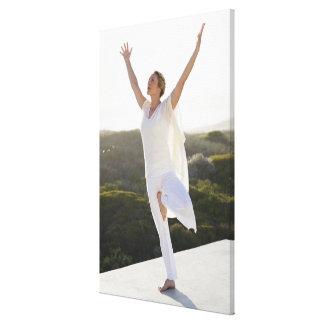 Mid adult woman practicing yoga 2 canvas print