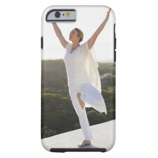 Mid adult woman practicing yoga 2 tough iPhone 6 case