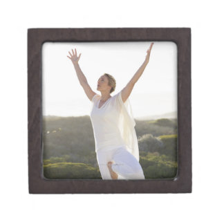Mid adult woman practicing yoga 2 keepsake box