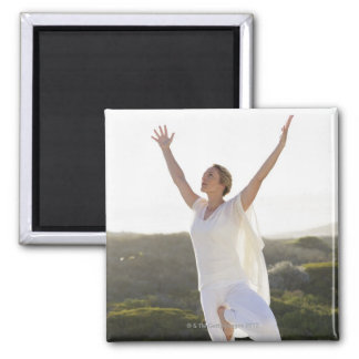 Mid adult woman practicing yoga 2 refrigerator magnet