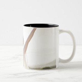 Mid adult woman practicing yoga 2 Two-Tone coffee mug